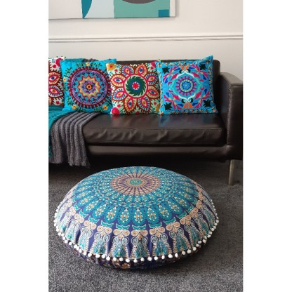 Bright cushions on leather couch and round floor cushion