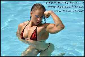 Monic flexes her biceps