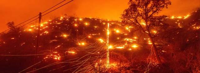© Noah Berger/AP | Flames dot the hills in Napa County as firefighters battle a series of blazes.