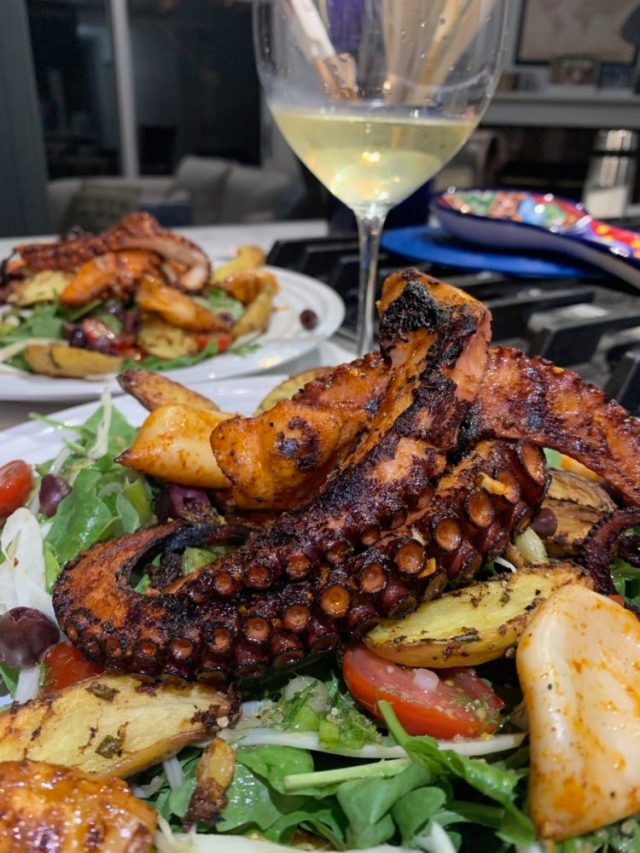 Grilled octopus served on top of a roasted potato, arugula, and fennel salad tossed with fresh tomatoes, kalamata olives, and a homemade honey-white wine vinaigrette.
