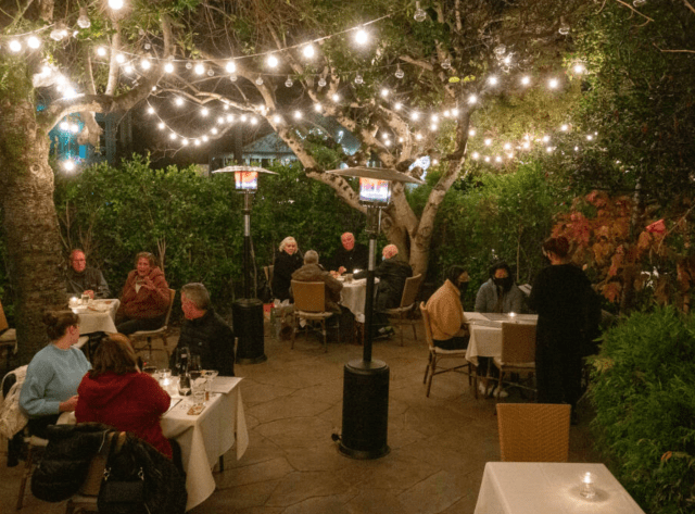 Customers have dinner in the courtyard of Ca'Bianca Ristorante Italiano in Santa Rosa on Thursday, Dec. 10, 2020. Businesses in Sonoma County will have to weather another stay-at-home order intended to reduce the spike in COVID-19 cases. (Alvin A.H. Jornada / The Press Democrat)