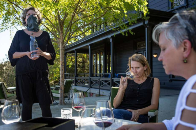 Kim Wertz hosts a wine tasting for Jen Beloz and Kim Westerman at the Faust Haus in St. Helena, California. Photo: Rachel Bujalski / Special to The Chronicle