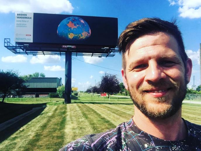 Photo of me with my billboard mural, Summer 2018