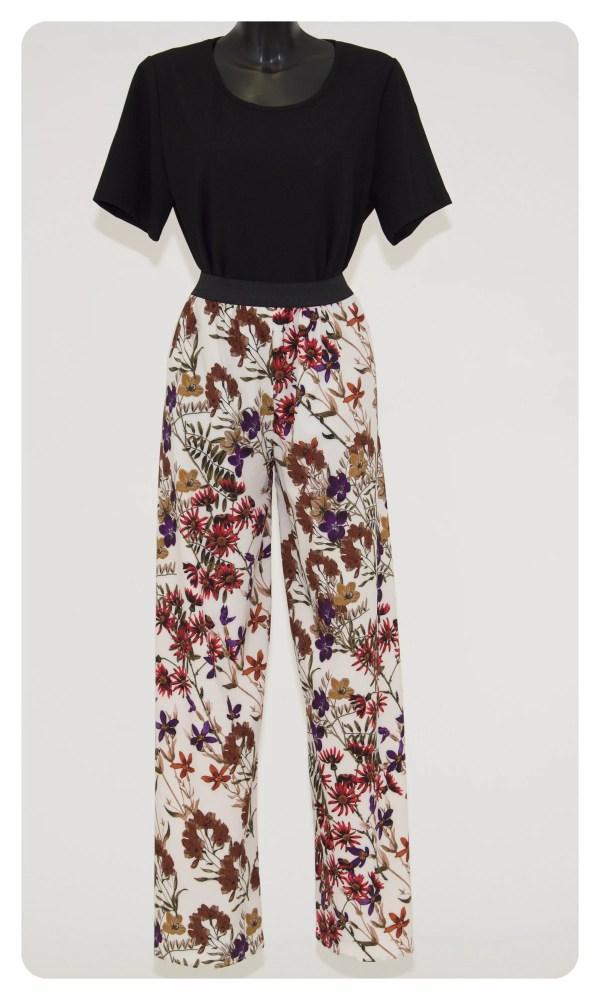 Pantalone Linda, in tessuto kadì, gamba larga con fantasia floreale colorata su base bianca ed elastico nero in vita -Marzia B