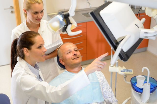 The dentist explains the results to the patient - Mississauga Dentist - Bristol Dental