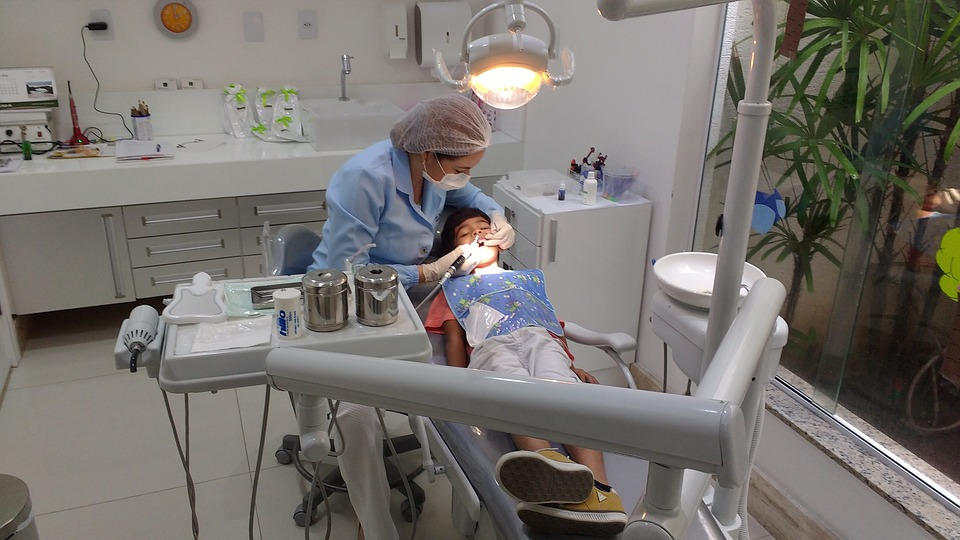 A dentist performing a dental cleaning on a child - Mississauga Dentist - Bristol Dental