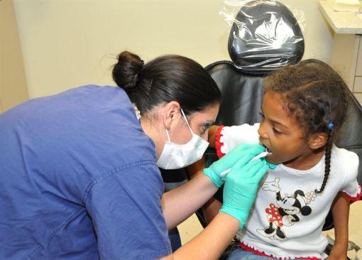 a dentist doing initial dental assessment
