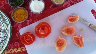 Learning to make roses out of tomato peel:)
