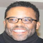 Terrence Brown Smiling in Black Sweater
