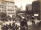 Ludgate Circus in London with carriages