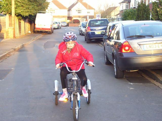 Niamh hits the road on her first trike, bought with funds raised by the Marlow Red Kite Ride