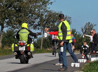Danish policeman takes on refreshments after towing tired Brit. Photo courtesy of UCI World Cycling Tour