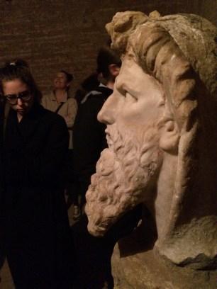 Maria admiring a statue bust