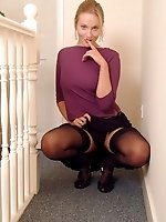 Blonde in black stockings shows her bushy pussy