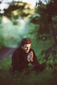 A picture of a man meditating.  Brittani Persha Counseling can help your entire family learn to meditate and improve their mental health. Houston, TX 77079