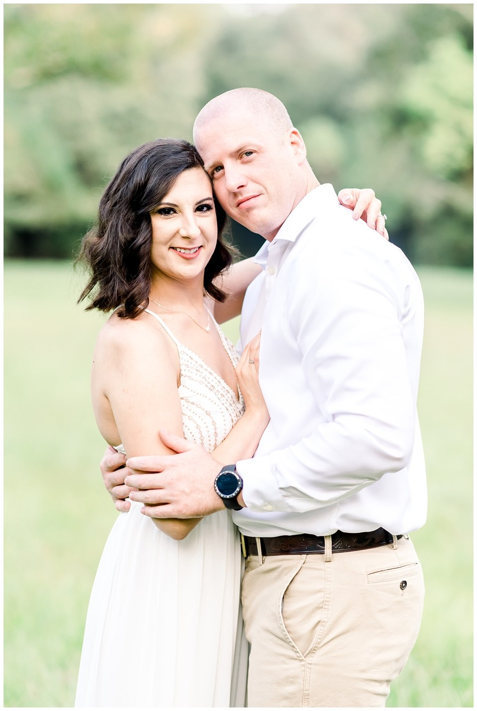 couple looking at camera during a baton rouge engagement session