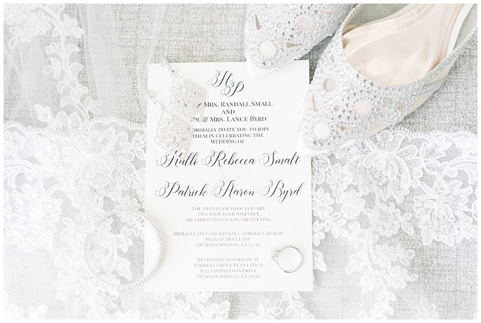 bridal details photo with invitation rings shoes and earrings