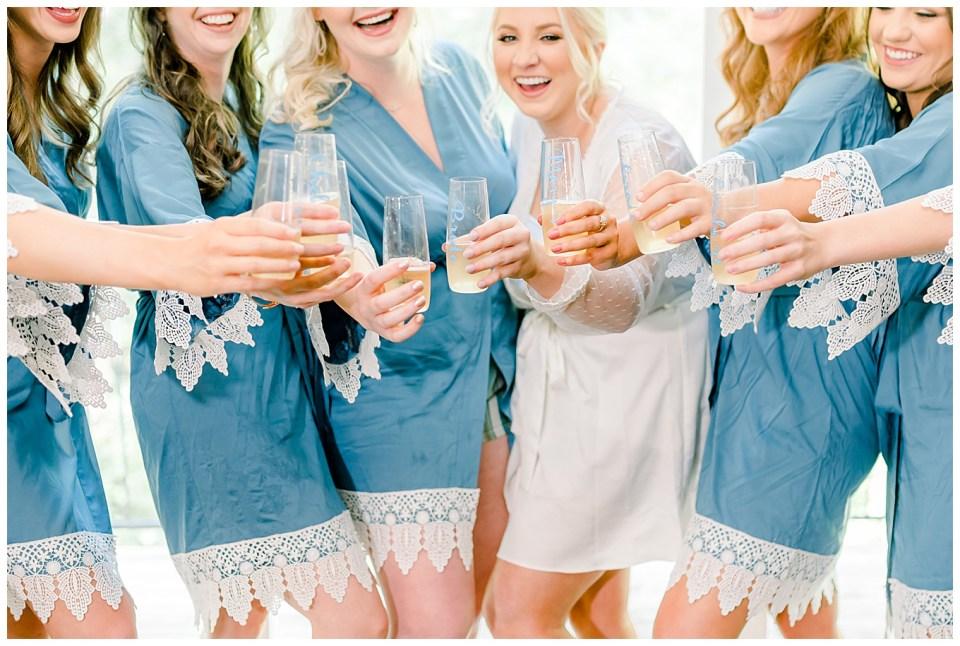 bride and bridesmaids toasting