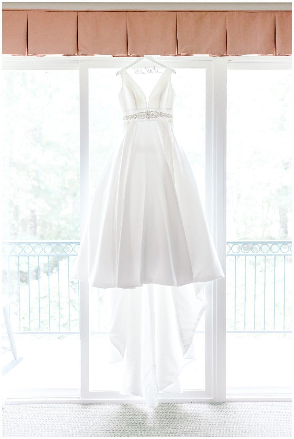 brides dress hung up with custom hanger