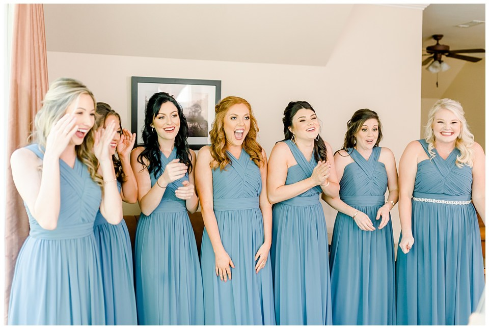bridesmaids reacting to seeing bride in her dress