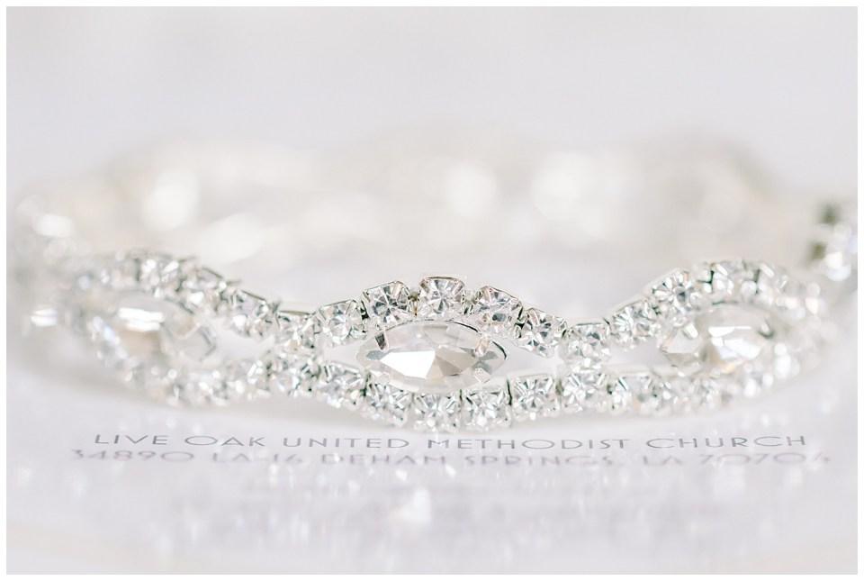wedding band detail with wedding invitation for a denham springs wedding