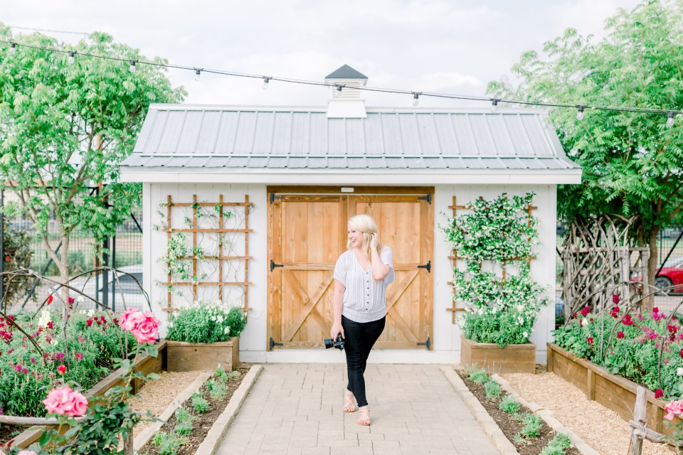 brittany bruce photography educator in front of white barn in a garden