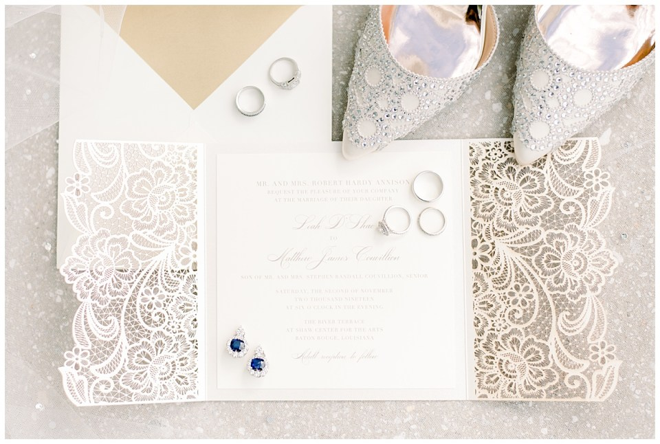 bright and airy wedding day details with invitation