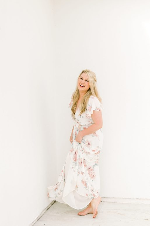 brittany-bruce-in-white-floral-dress-laughing