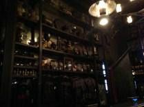 Inside Borgin and Burkes dimly lit shop.