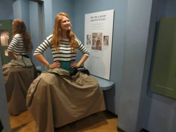 Amanda trying on a funny skirt
