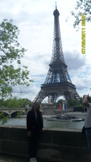 mom in front of the Eiffel Tower