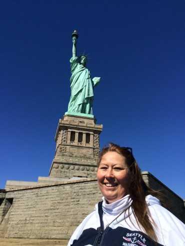 mom in front of the Statue of Liberty