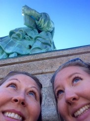mom and I looking up at the Statue of Liberty