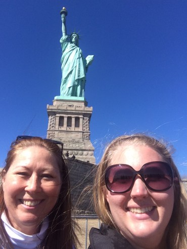 mom and I in front of the Statue of Liberty