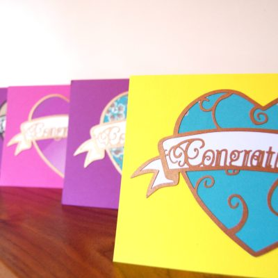 Art Nouveau Congratulations Cards in a range of colours including yellow, purple and pink.