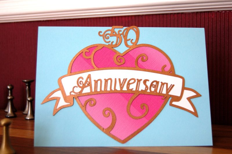 Layered paper cut Art Nouveau Congratulations Card in pastel blue with a pink patterned heart. This example was a custom commision for a 50th Anniversary so reads Anniversary instead of Congratulations.