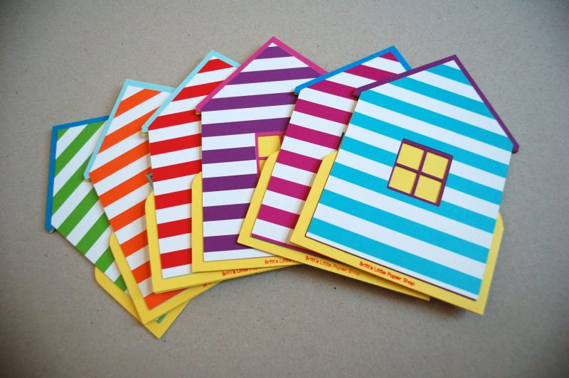 A range of Beach Hut cards in various colours and stripes.
