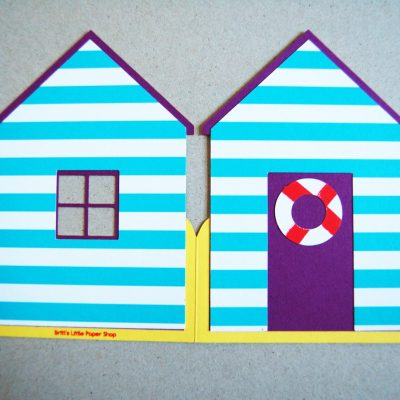 Beach Hut card shown flat, in purple with blue stripes.