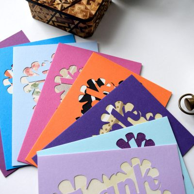 Thank You cards in various colours and patterns including purple, ocean blue, pastel blue, pink, orange and lilac.