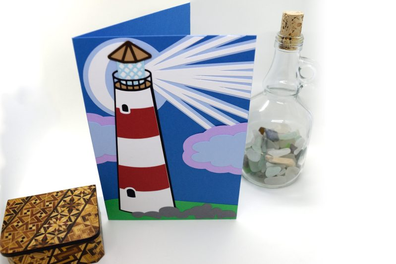 Lighthouse Greetings Card pictured from above front.