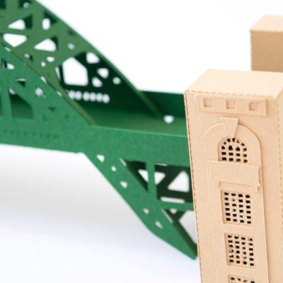 Tyne Bridge Activity Kit using green and tan card, close up on tower construction.