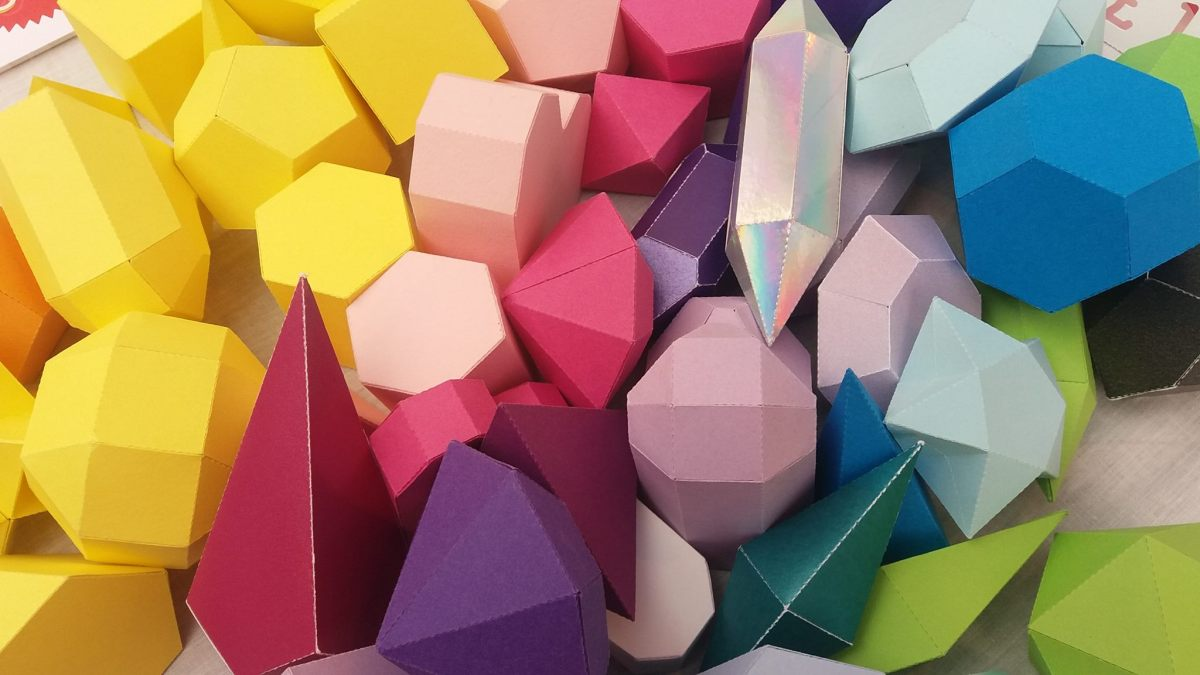 Colourful 3D paper shapes.