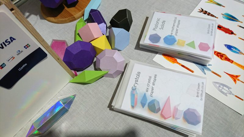 A photo of the 3D paper shapes activity kits packaged.