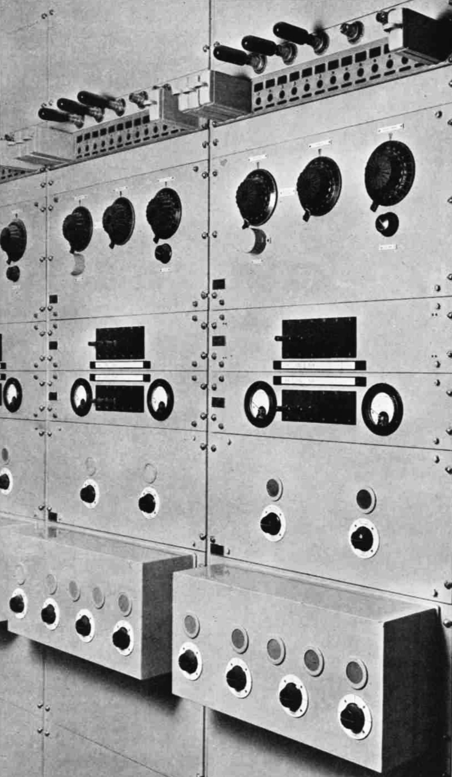 2 banks of equipment with dials and control knobs