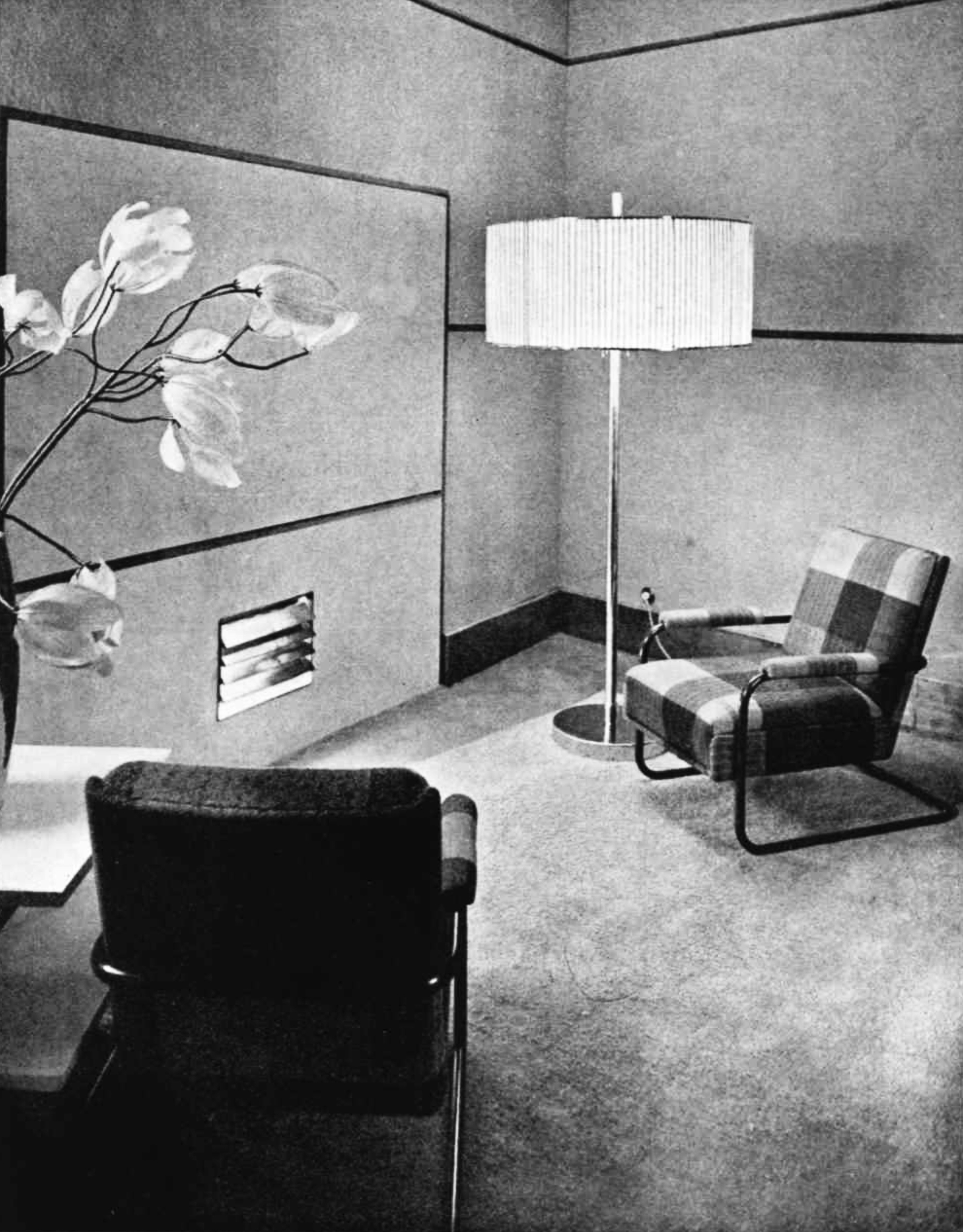 Two armchairs, a standard lamp and flowers in a cozy room
