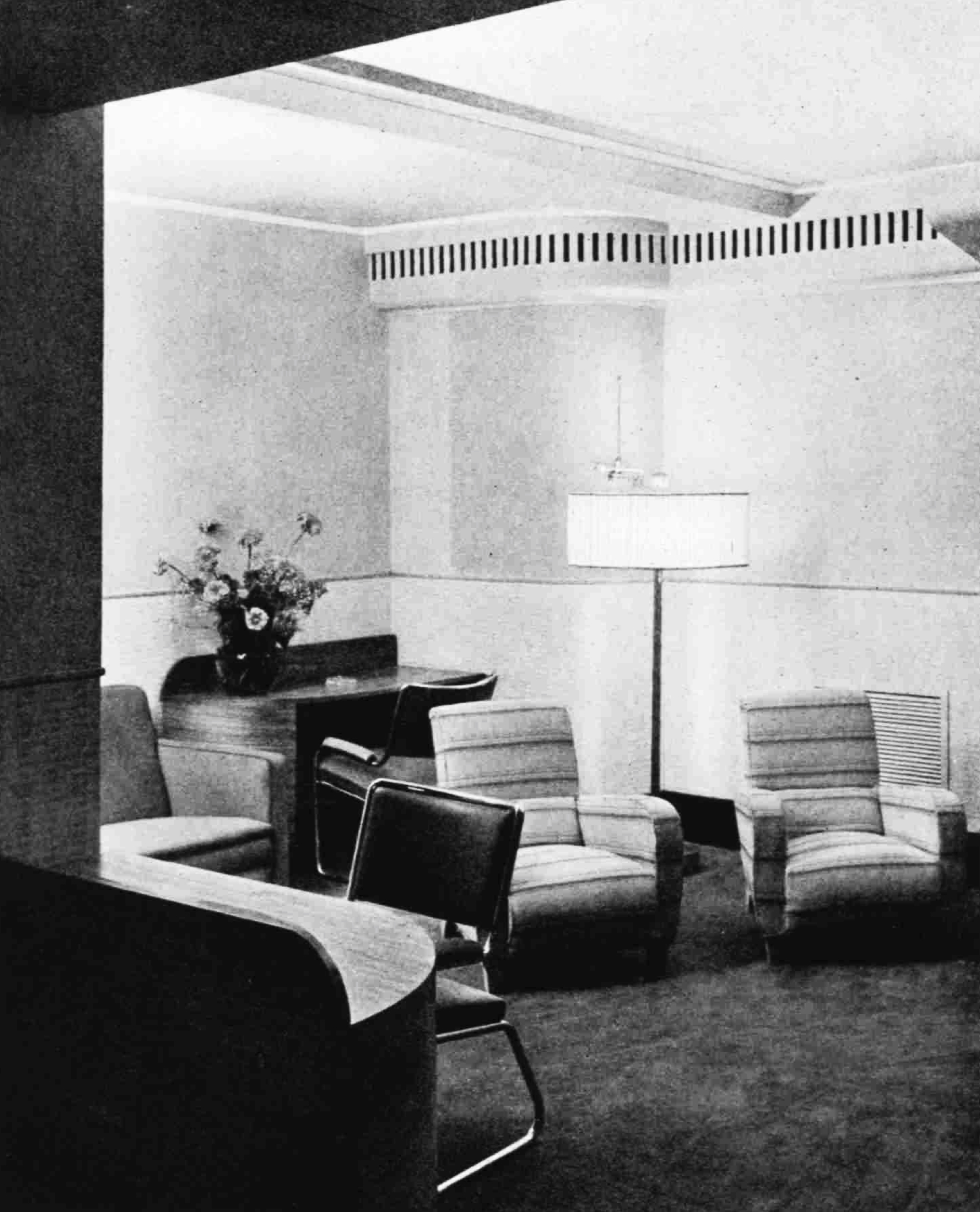 Comfortable chairs and a standard lamp