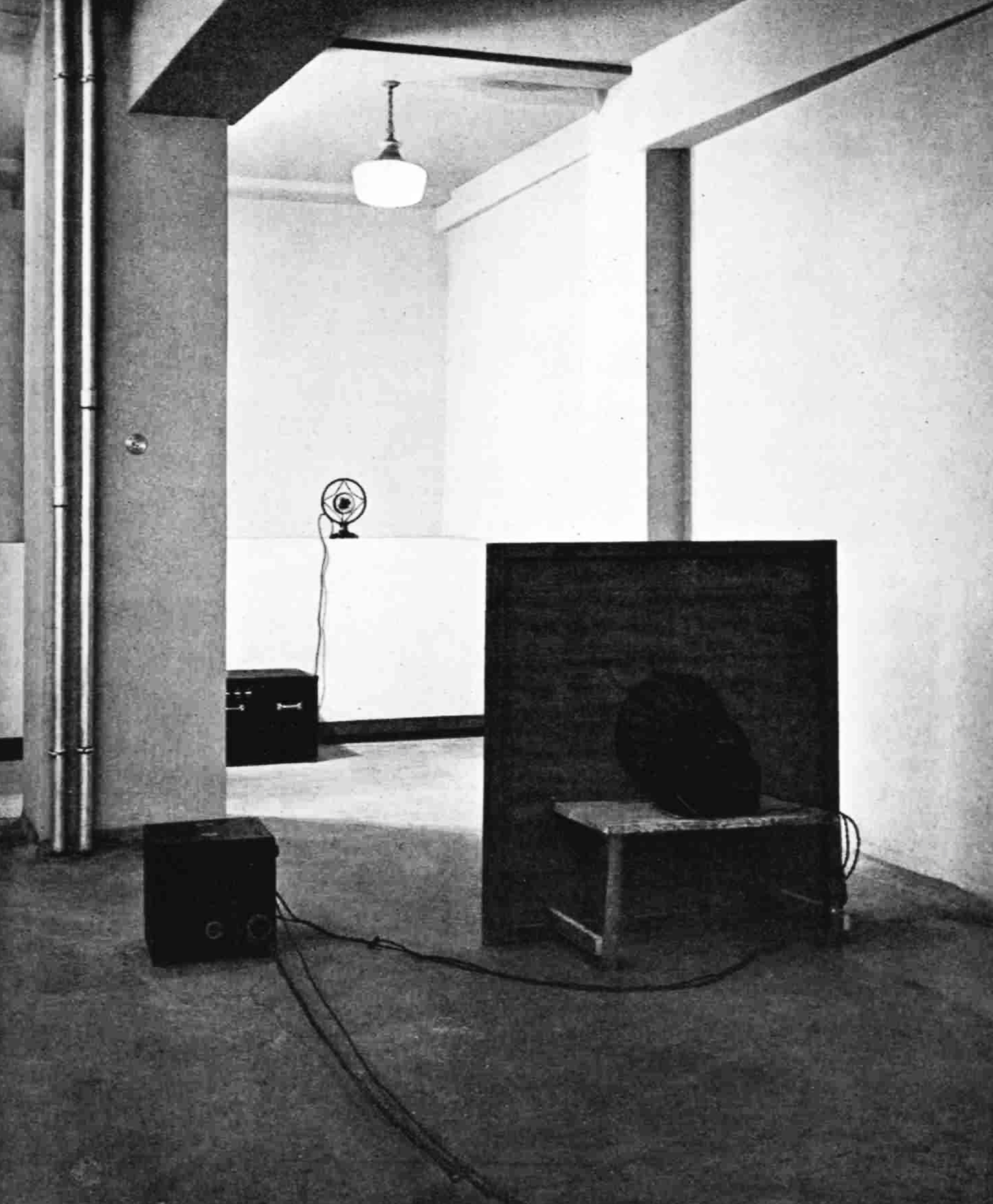 An empty space with a microphone and a large speaker