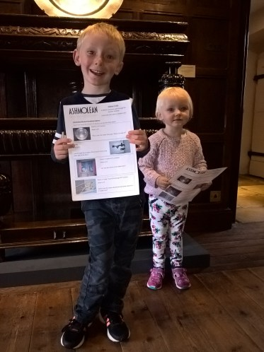 Layla and Pryce doing the Children's Trail at Ashmolean Museum Broadway