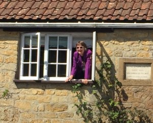 Margery at her window.