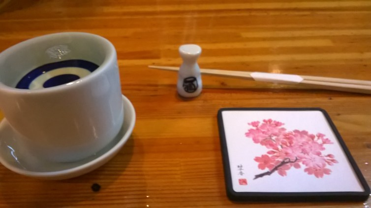 My lovely place setting - that glass is literally overflowing with sake
